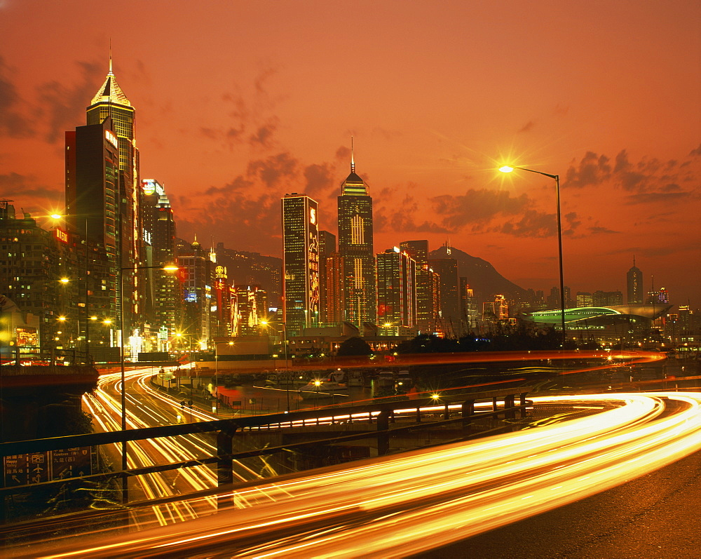 Lights on skyscrapers and traffic trails in the financial district of Hong Kong at sunset, China, Asia