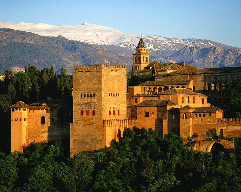 The Alhambra Palace, UNESCO World Heritage Site, with the snow covered Sierra Nevada mountains in the background, Granada, Andalucia, Spain, Europe