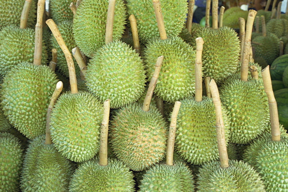 Durian fruit piled up for sale in Bangkok, Thailand, Southeast Asia, Asia