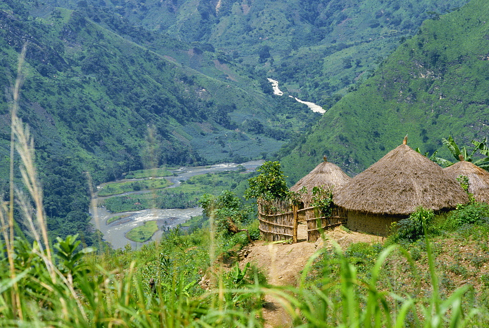 Native huts in a valley near Uriva, Zaire, Africa