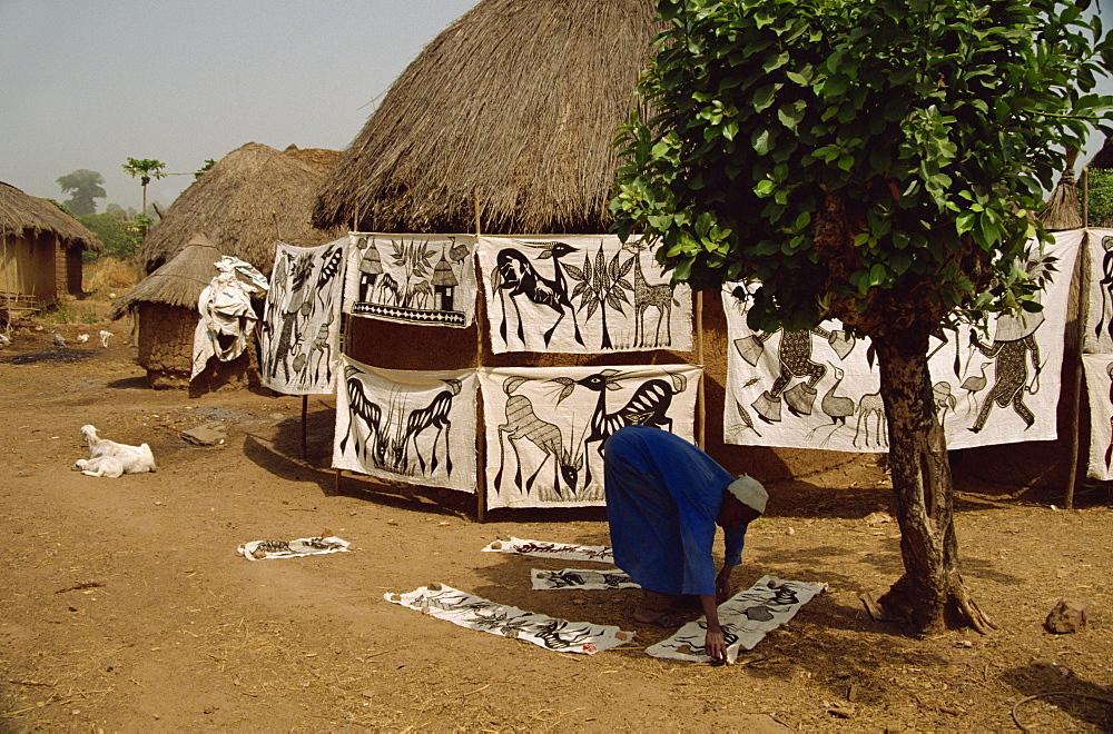 Batiks hanging on line in village near Korhogo, Ivory Coast, West Africa, Africa
