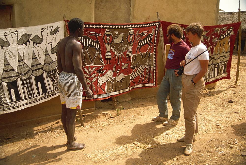 Tourists being shown batiks, near Korhogo, Ivory Coast, West Africa, Africa