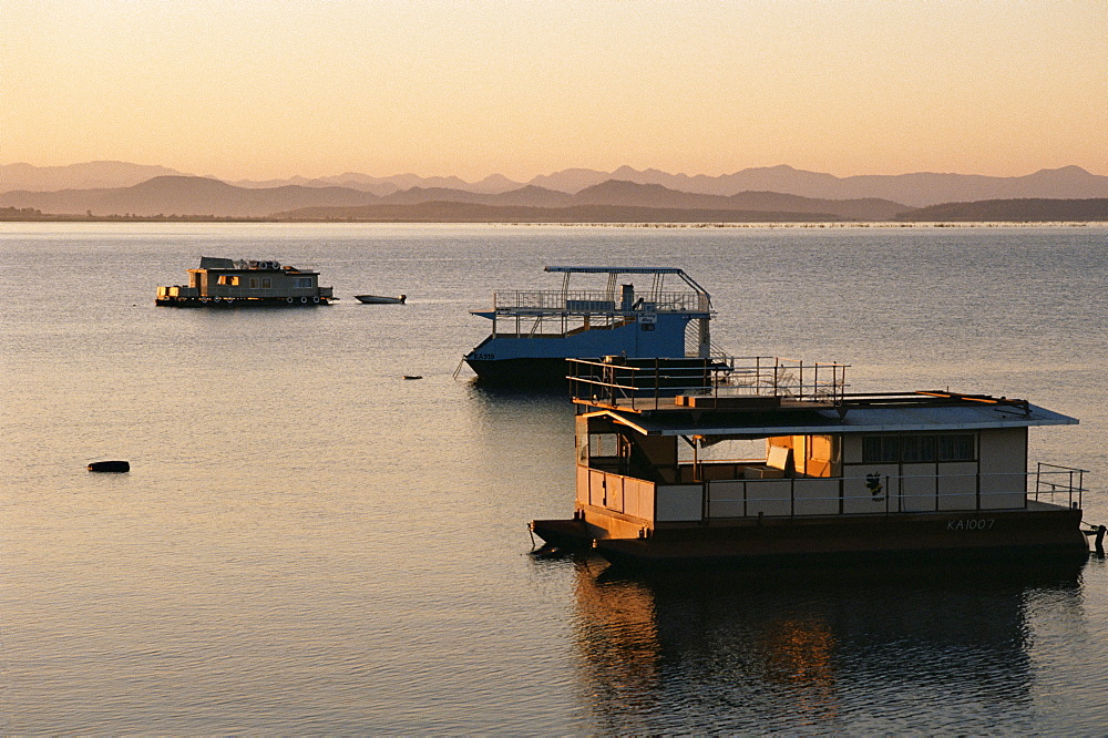 Houseboats at dawn at Cutty Sark Hotel marina, Lake Kariba, Zimbabwe, Africa