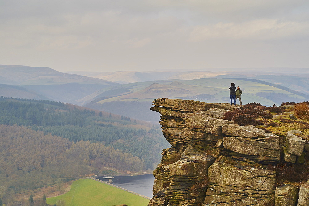 Walkers taking in the view on Hathersage Edge, Ladybower Reservoir below, Peak District National Park, Derbyshire, England, United Kingdom, Europe - 358-601