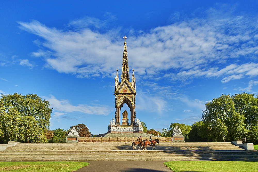 Three heavy horses are ridden past The Albert Memorial, Kensington Gardens, Hyde Park, London, England, United Kingdom, Europe - 358-607