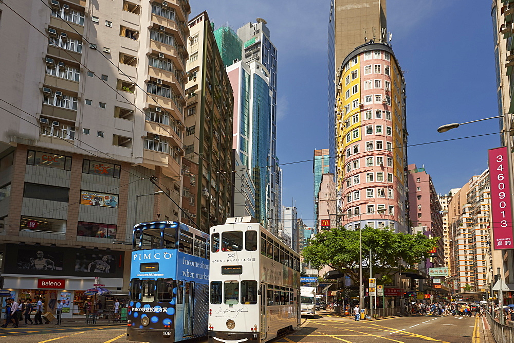 Trams passing through the shopping district, Wan Chai, Hong Kong, China, Asia