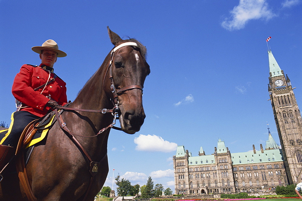 Royal Canadian Mounted Policeman outside the Parliament Building in Ottawa, Ontario, Canada, North America - 358-95