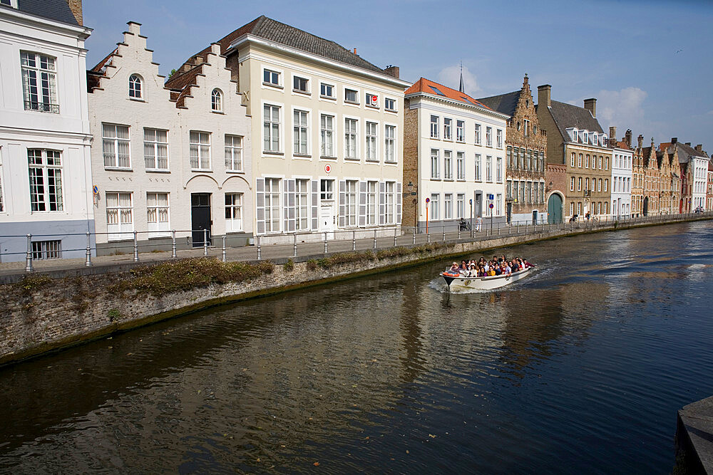 Spinolarei canal with builidings on Sint-Annarei and approaching boat carrying tourists, Bruges, Belgium - 365-3854