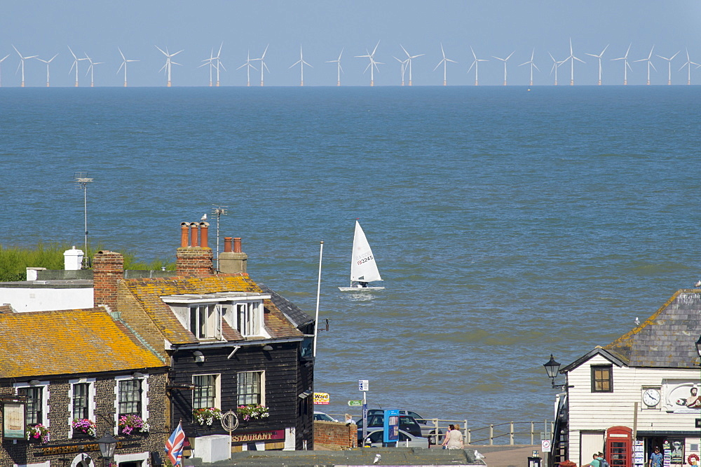 Sailing dinghy passes Broadstairs with Thanet Windfarm in background, Kent, England, United Kingdom, Europe