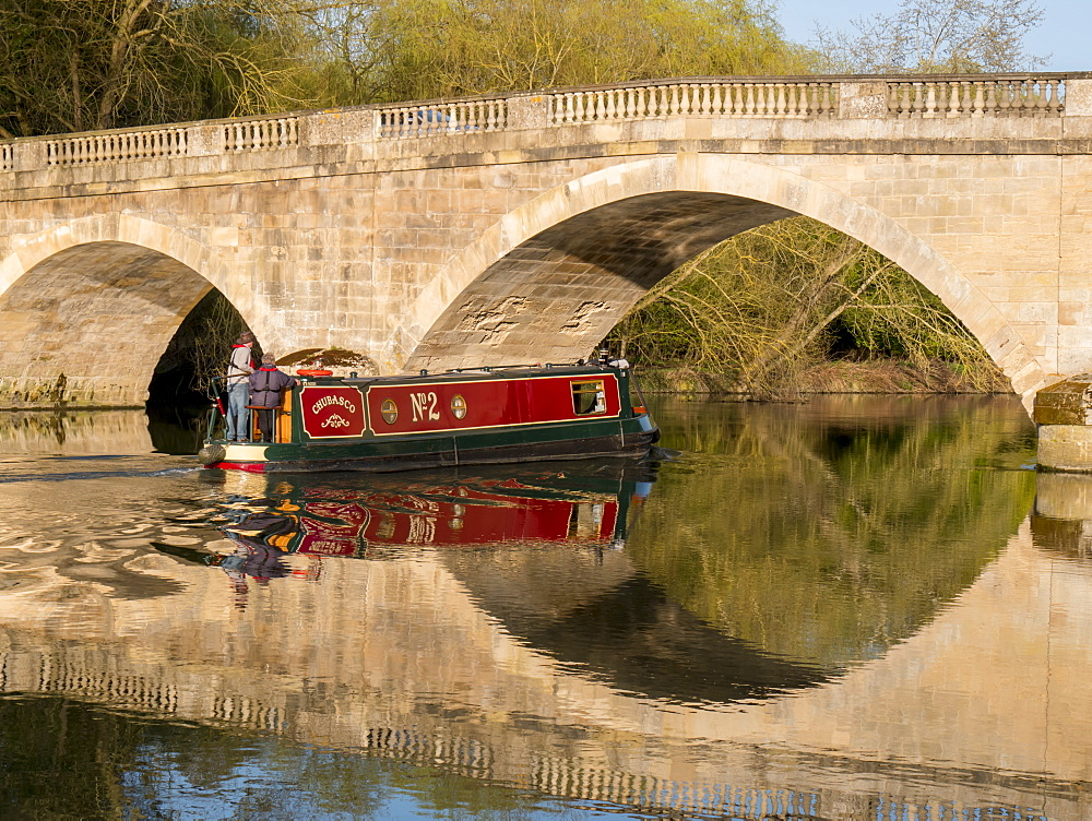Red narrow boat passes under Shillingford Bridge reflected in River Thames, Shillingford, Oxfordshire, England, United Kingdom, Europe - 367-6140