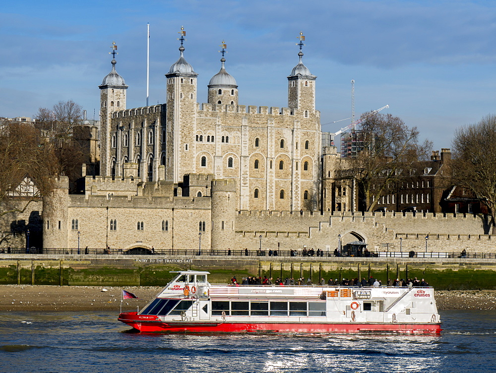 Tower of London, UNESCO World Heritage Site across the River Thames with tour boat, London, England, United Kingdom, Europe - 367-6156
