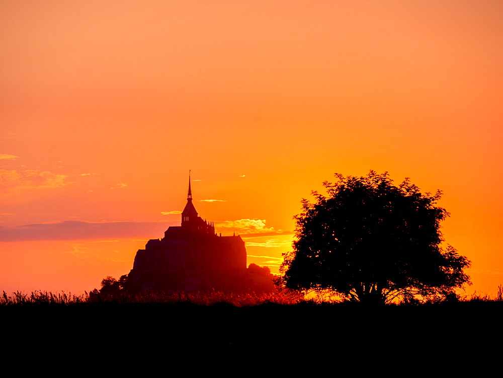 Mont St. Michel, UNESCO World Heritage Site, holy island and peninsula at sunset, Normandy, France, Europe