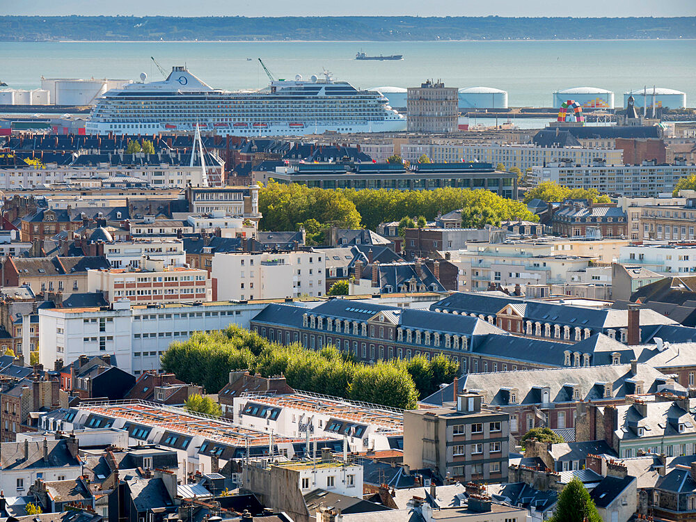 City skyline towards Seine estuary with cruise ship in docks, Le Havre, Normandy, France, Europe