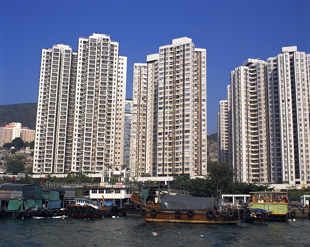 Boats in the harbour and new high rise apartment blocks for people who lived in sampans, at Aberdeen, Hong Kong, China, Asia