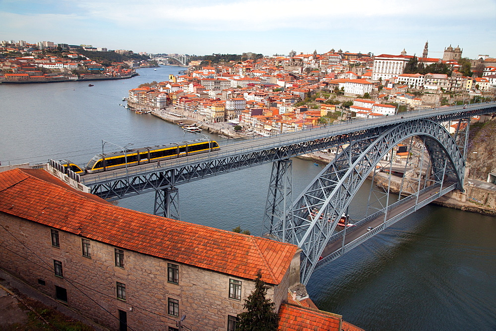 The Dom Luis 1 Bridge over the River Douro showing Porto Metro light rail in transit and Arrabida Bridge in background, Porto (Oporto), Portugal, Europe