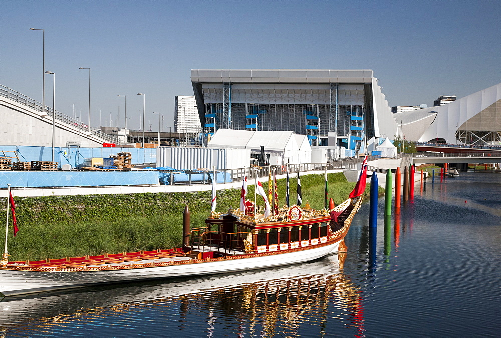 The Royal Barge Gloriana at the Olympic Park showing the Aquatics Centre in background, Stratford, London, England, United Kingdom, Europe - 377-3908