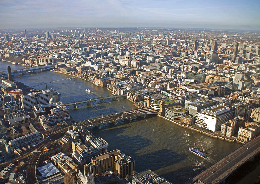 Aerial view of the City of London from the top of the Shard showing the River Thames, London Bridge, Southwark Bridge, Millennium Bridge, Blackfriars Bridge and St. Paul's Cathedral, London, England, United Kingdom, Europe - 377-3952
