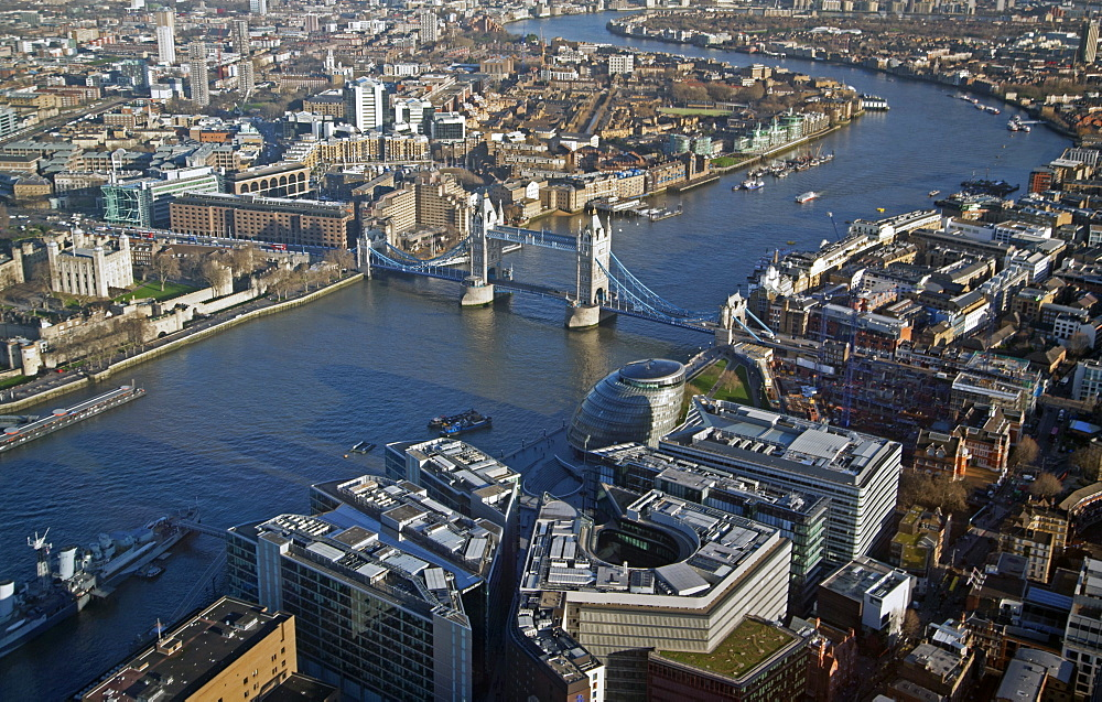 Aerial view from the top of the Shard towards Tower Hill showing the River Thames bend, Tower Bridge, The Tower of London, City Hall and More London Riverside, London, England, United Kingdom, Europe - 377-3954