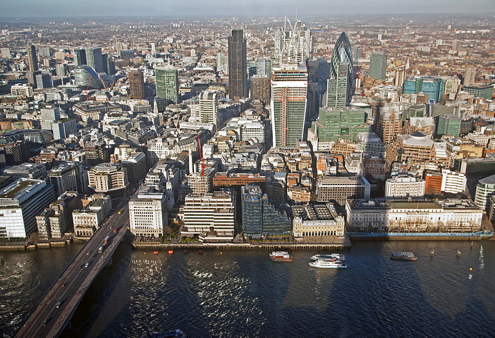 Aerial view of the City from the top of the Shard showing River Thames, London Bridge, 30 St. Mary Axe (The Gherkin), Tower 42, the Willis Building, and Moorhouse, London, England, United Kingdom, Europe - 377-3955