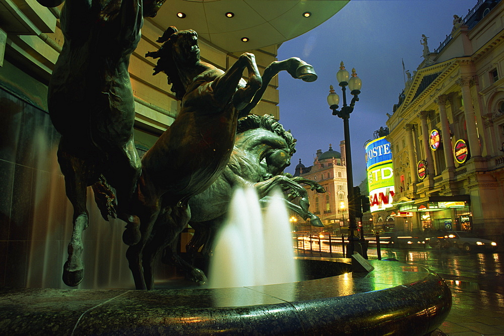 Water fountain with horse statues, Piccadilly Circus, London, England, United Kingdom, Europe