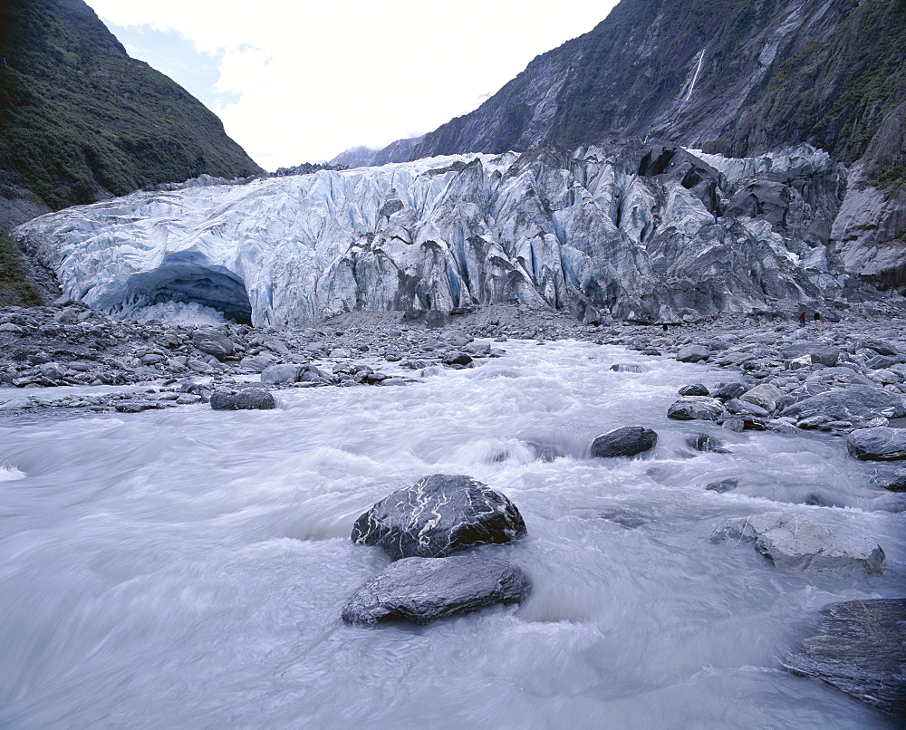 Melt water and glacial rock terrain at glacier terminus, Waiho River, Franz Joseph Glacier, Westland National Park, South Island, New Zealand, Pacific