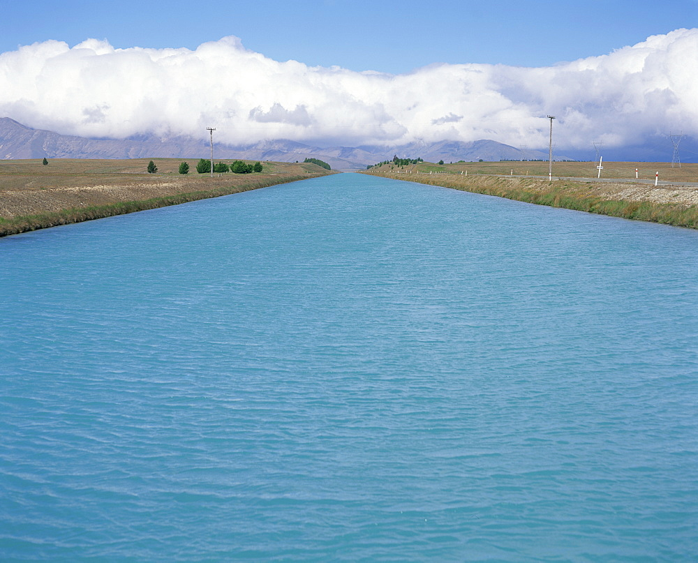 Hydro canal between Lakes Tekapo and Pukaki in a hydro-electric power scheme in Canterbury, South Island, New Zealand, Pacific
