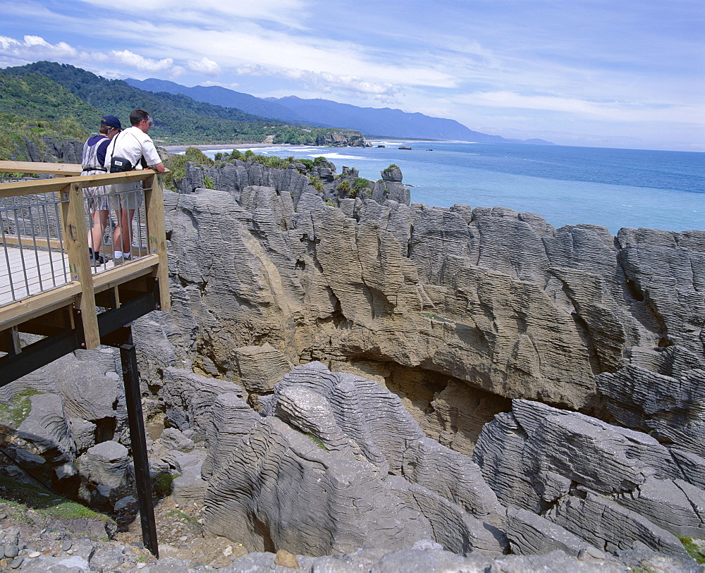 Tourists on viewing platform, Punakaiki, Pancake Rocks and blowholes, Paparoa National Park, Westland, South Island, New Zealand, Pacific