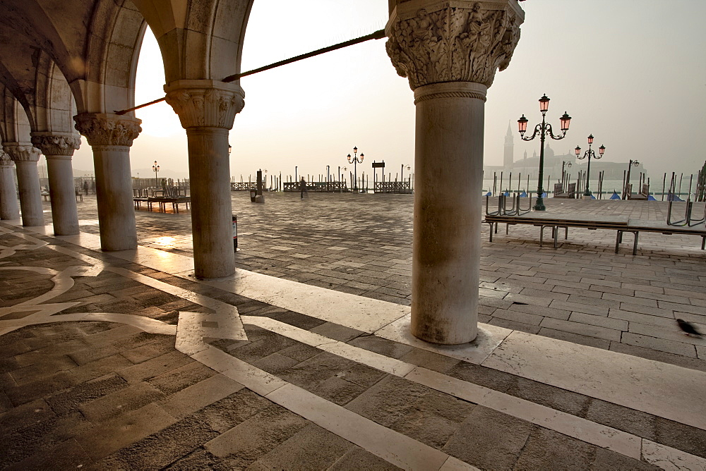 Cloisters of the Palazzo Ducale, St Marks Square, looking to Isola di San Giorgio Maggiore in the early morning, Venice, UNESCO World Heritage Site, Veneto, Italy, Europe - 385-1671