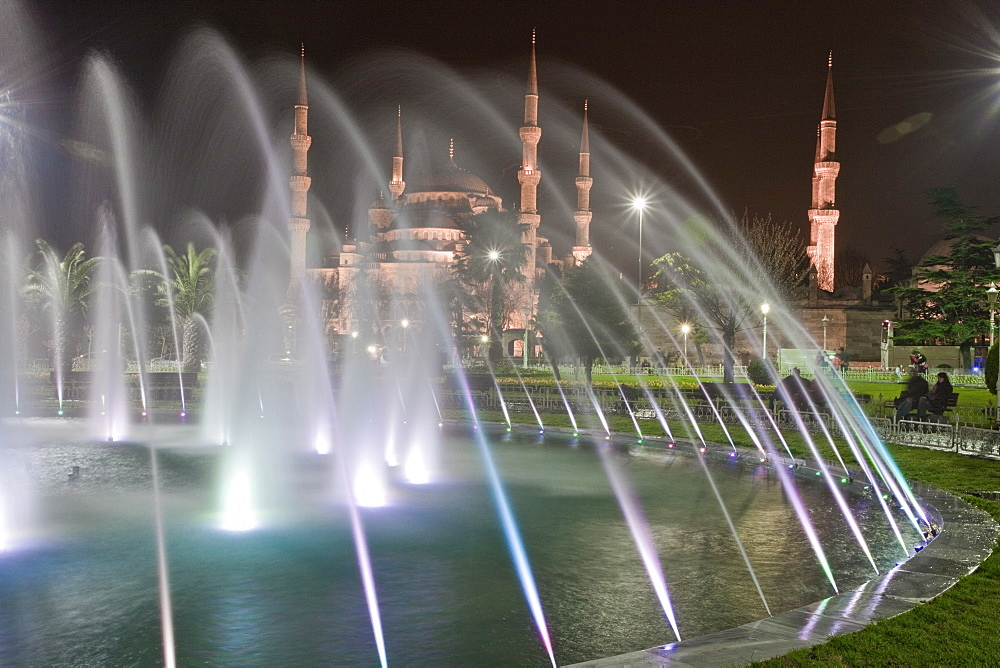 Coloured fountains at night in Sultan Ahmet Park, a favourite gathering place for locals and tourists, looking towards the Blue Mosque, Istanbul, Turkey, Europe - 385-1690
