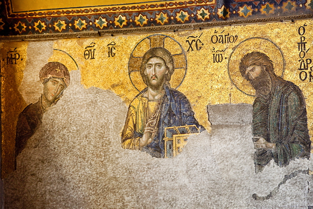 The Deesis Mosaic, depicting Christ Pantrocrator flanked by the Virgin Mary and St. John the Baptist, dating from the Restoration of Constantinople in 1261 at the end of Crusader occupation, Aya Sofya (Hagia Sophia), UNESCO World Heritage Site, Istanbul, Turkey, Europe - 385-1696