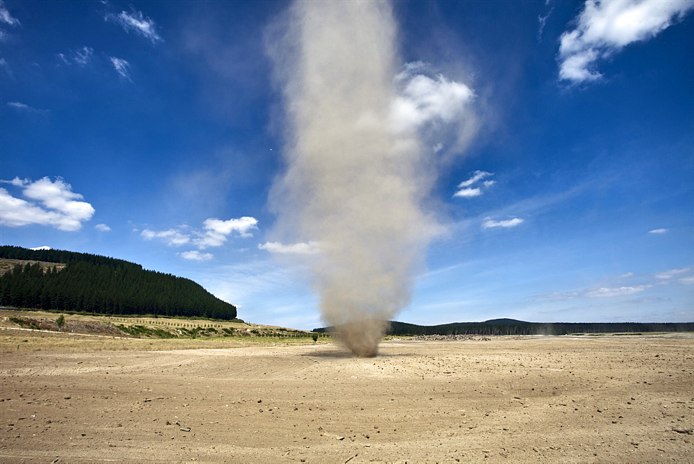 Dust whirlwind twister during summer drought on farm, Waikato, North Island, New Zealand, Pacific
