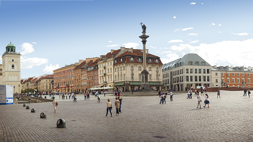 Tourists walk across Castle Square Plac Zamkowy, site of Sigismund's Column and Royal Castle - UNESCO old town rebuilt after WW2 - 385-1779