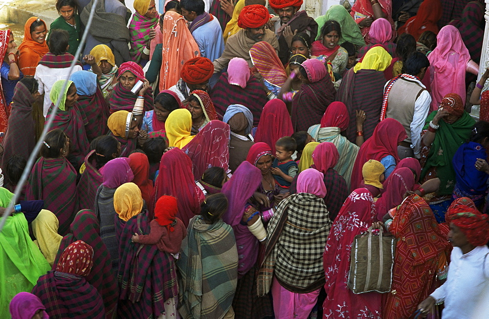 Women from villages crowd the street at the Camel Fair, Pushkar, Rajasthan state, India, Asia
