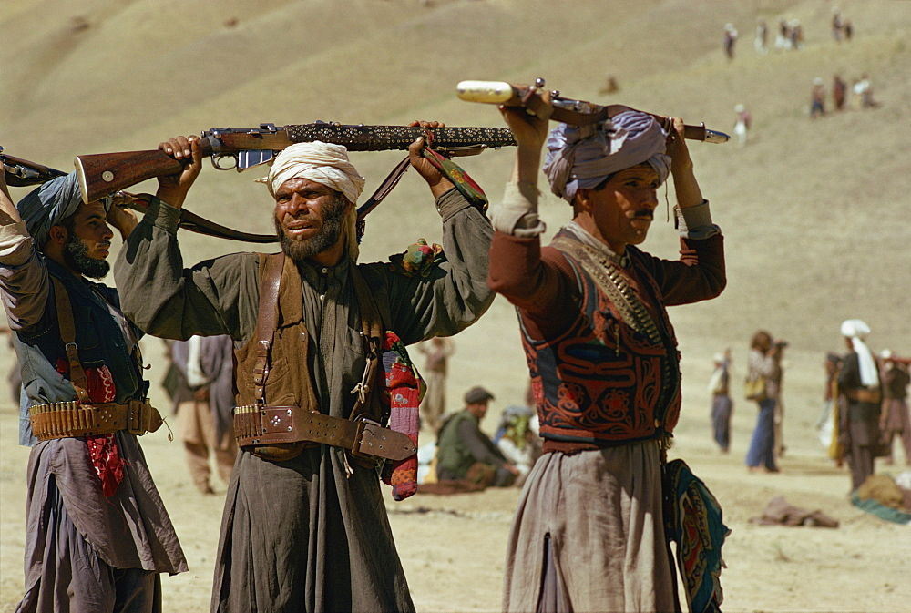 Pushtoon tribesmen dancing at Jeshan celebration, Bamiyan, Afghanistan, Asia - 39-2454