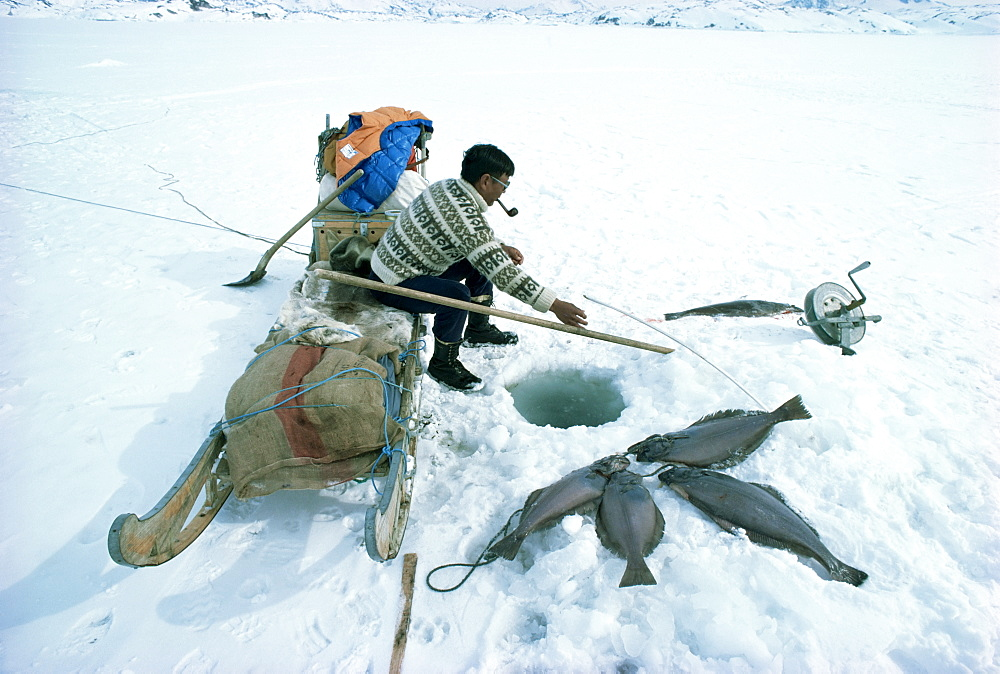 Inuit man fishing for halibut, eastern area, Greenland, Polar Regions