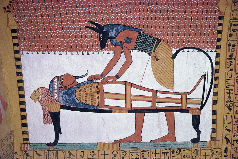 Mural showing the god Anubis leaning over mummy of Ramses II, in the Tomb of Sinjin, chief artist to Ramses II, Deir el Medina, Thebes, UNESCO World Heritage Site, Egypt, North Africa, Africa