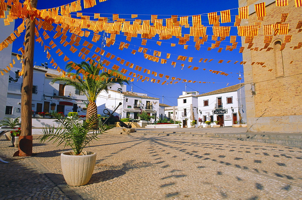 Town square with streamers in regional colours, Altea, Alicante, Valencia, Spain, Europe