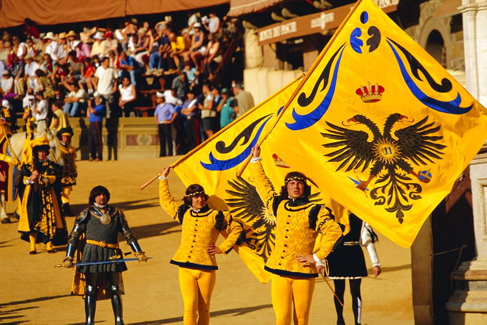 The Palio, standard bearers of the Aquila (Eagle) contrada, Siena, Tuscany, Italy, Europe