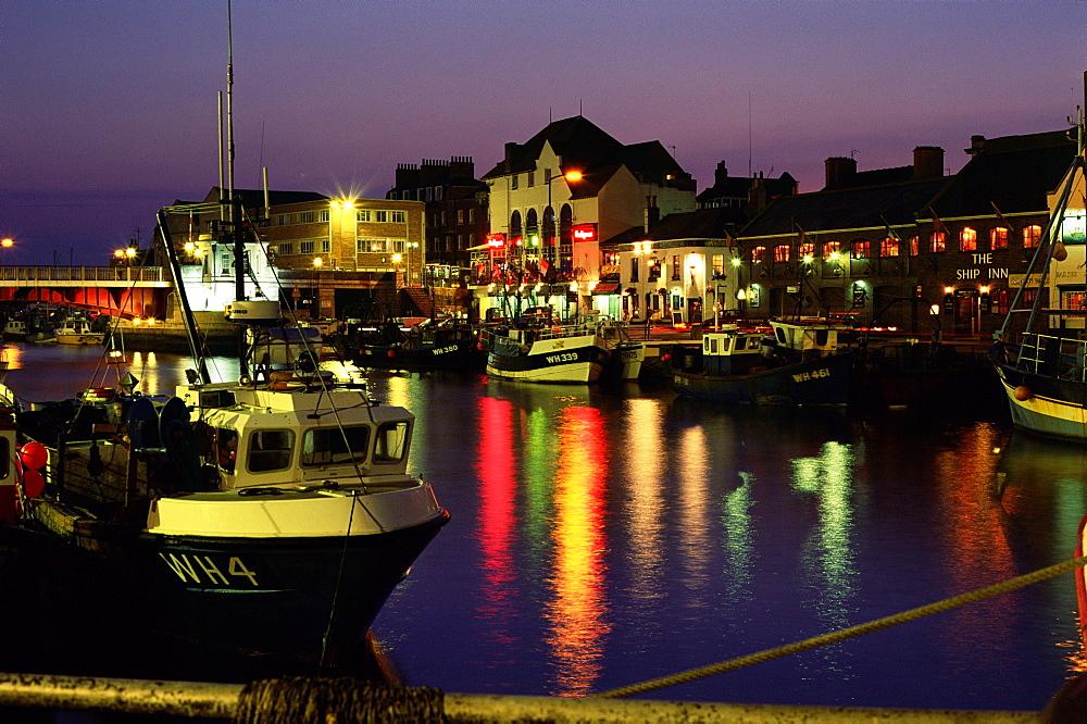 The Old Harbour, illuminated at dusk, Weymouth, Dorset, England, UK, Europe