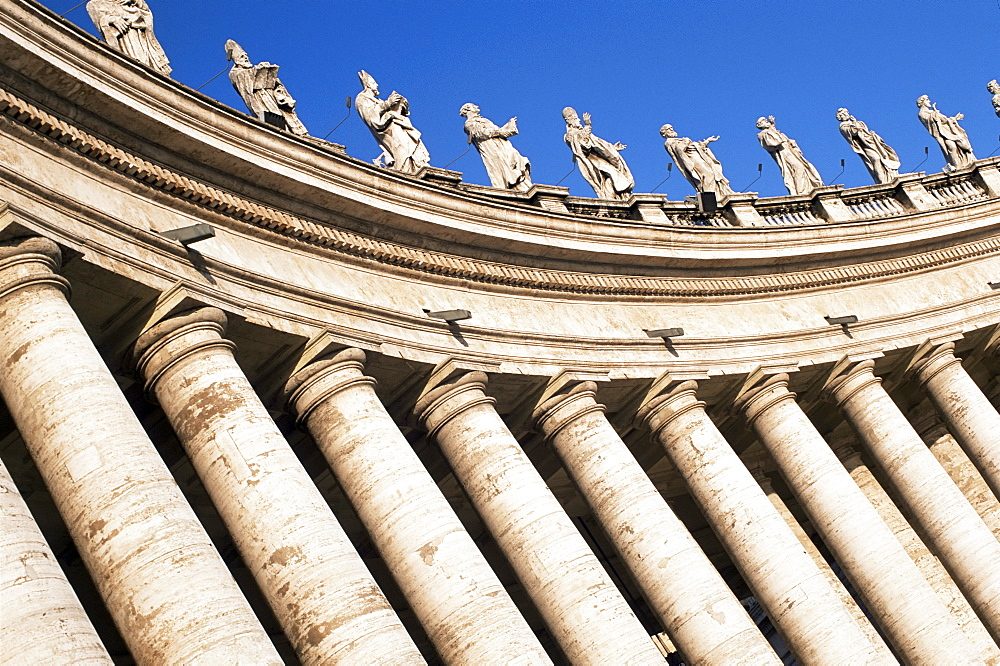 Gian Lorenzo Bernini's 17th century colonnade and statues of saints, Piazza San Pietro, St. Peter's, Vatican City, Rome, Lazio, Italy, Europe - 390-2498