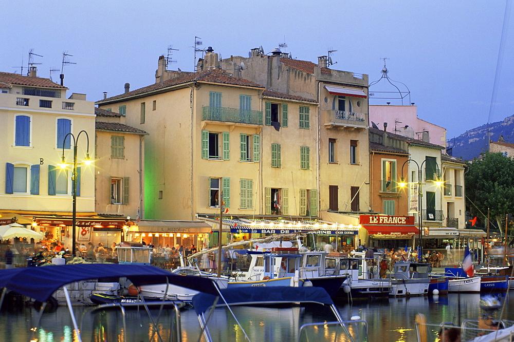 View across the harbour at dusk, Cassis, Bouches-de-Rhone, Provence-Alpes-Cote-d'Azur, France, Europe