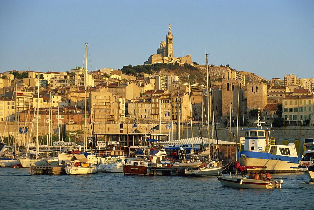 View across the Vieux Port to the basilica of Notre Dame de la Garde, Marseille, Bouches-du-Rhone, Provence, France, Mediterranean, Europe