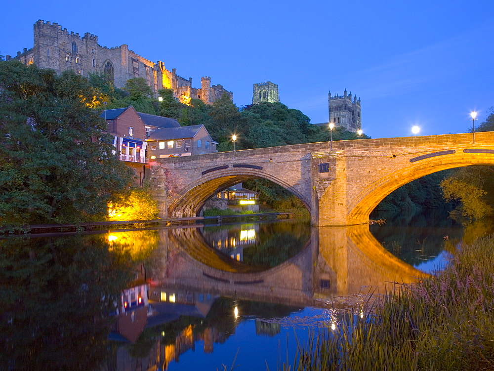 View to the illuminated castle and cathedral across the River Wear below Framwellgate Bridge, Durham, County Durham, England, United Kingdom, Europe