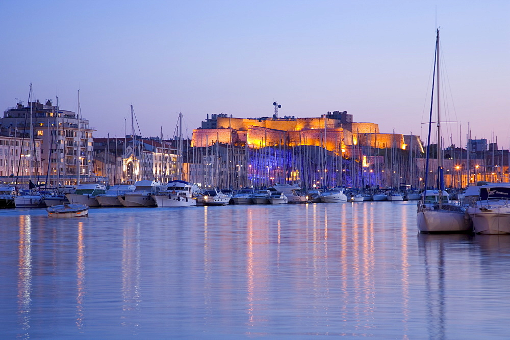 View across the Vieux Port to the illuminated Fort St.-Nicolas at dusk, Marseille, Bouches-du-Rhone, Cote d'Azur, Provence, France, Europe