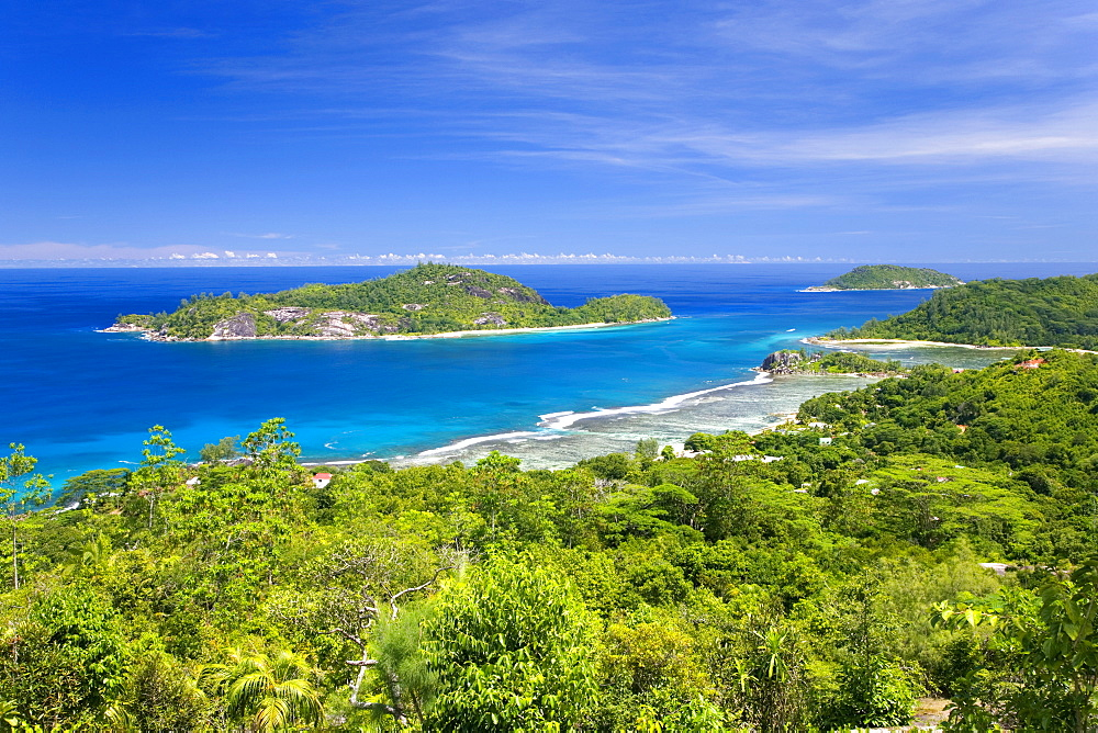 View across Anse l'Islette to the offshore islands of Therese and Conception from hillside above Port Glaud, Port Glaud district, Island of Mahe, Seychelles, Indian Ocean, Africa