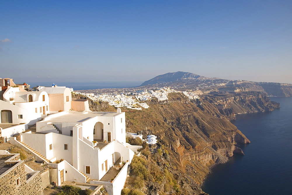 View along volcanic cliffs towards distant Fira, Imerovigli, Santorini (Thira) (Thera), Cyclades Islands, South Aegean, Greek Islands, Greece, Europe