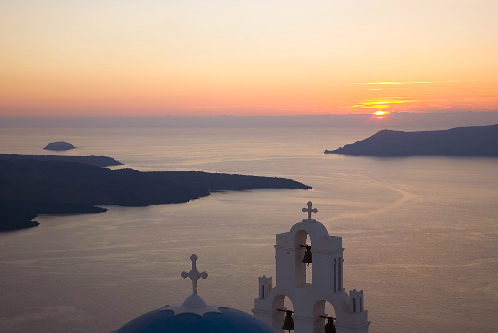 Sunset over the caldera, typical church in foreground, Firostefani, Santorini (Thira) (Thera), Cyclades Islands, South Aegean, Greek Islands, Greece, Europe