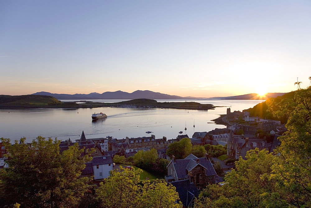 View over Oban Bay from McCaig's Tower, sunset, ferry coming into port, Oban, Argyll and Bute, Scotland, United Kingdom, Europe - 390-2901