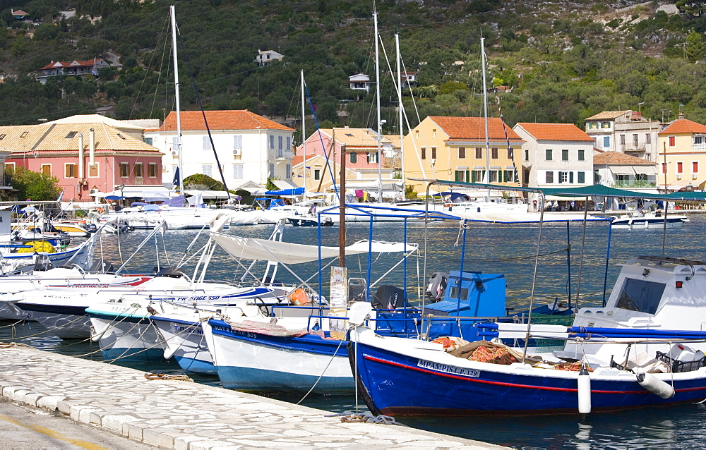 View across the harbour to colourful waterfront buildings, Gaios, Paxos, Paxi, Corfu, Ionian Islands, Greek Islands, Greece, Europe