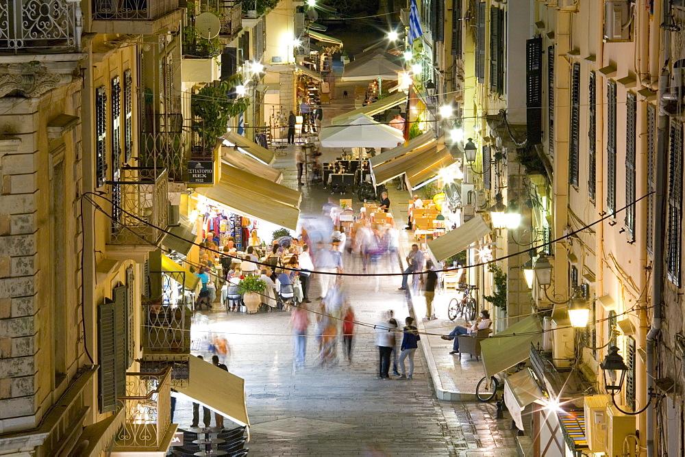 View by night over illuminated Odos Kapodistriou, Corfu Town, Corfu, Ionian Islands, Greek Islands, Greece, Europe